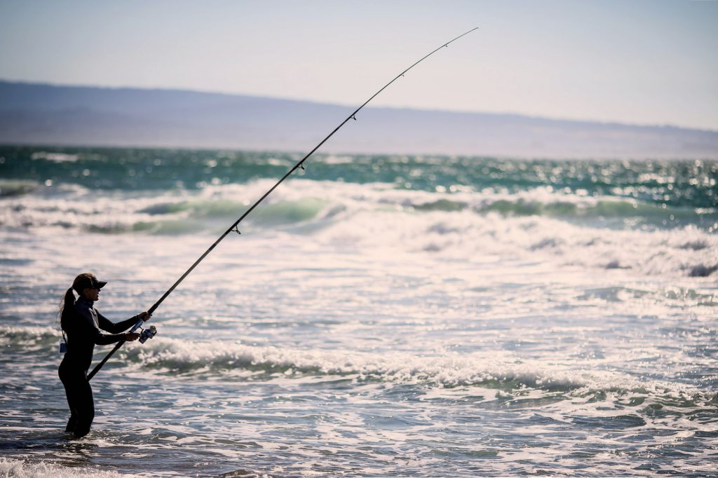 Woman surf fishing