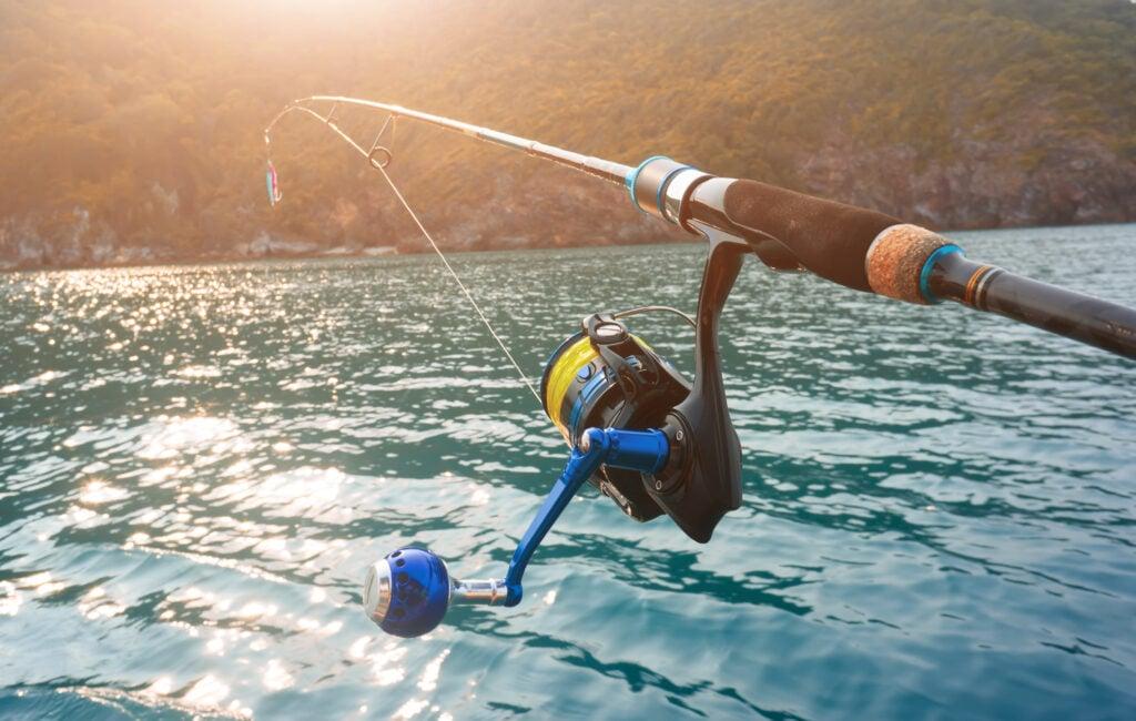 Spinning reel on fishing rod in saltwater