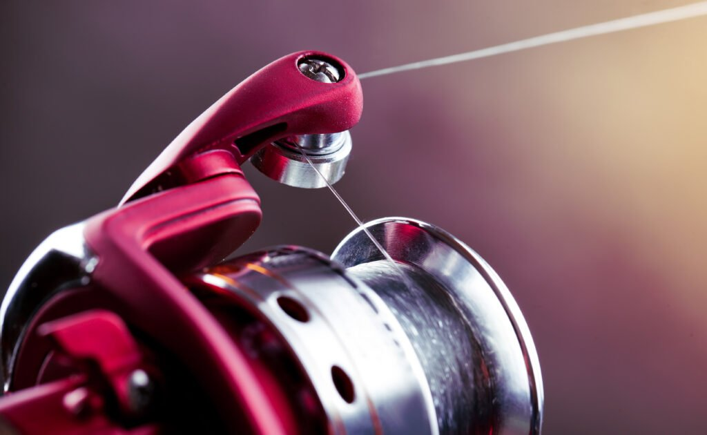 closeup of fishing line on a fishing reel