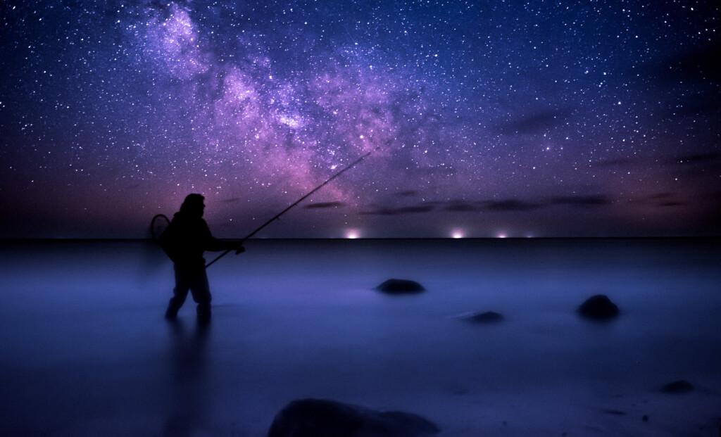 man fishing for catfish at night