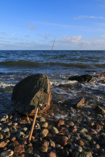 inshore sea trout fishing by the sea, spinning rod