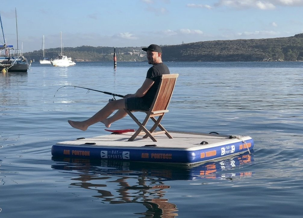 man fishing from an inflatable air pontoon