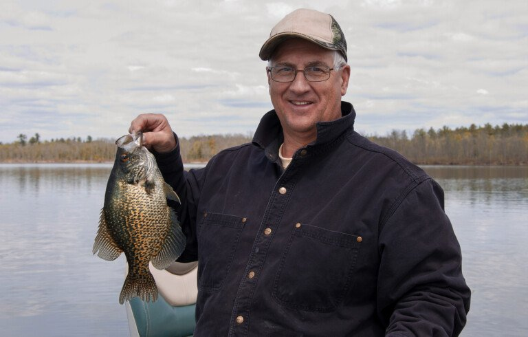 fisherman with a black crappie catch using his crappie rig