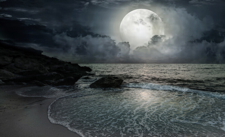 rising tides and the moon with waves over the beach